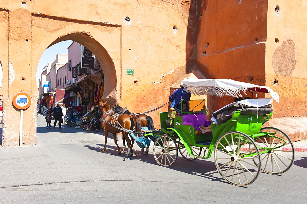Tourists in Marrakech enjoying a horse and cart ride around the old medina, Marrakech, Morocco, North Africa, Africa