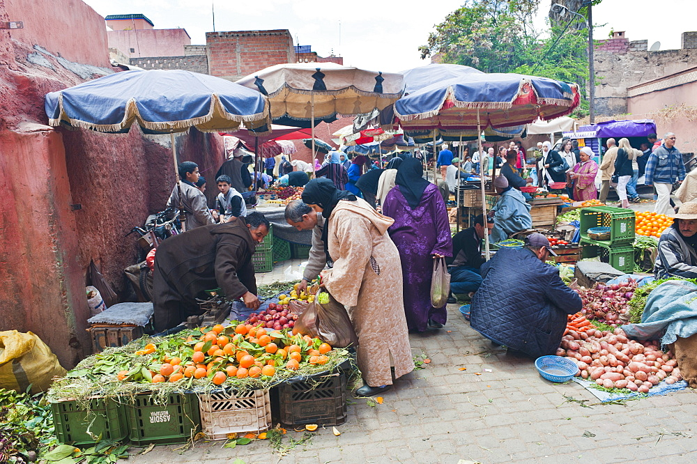 Moroccan people buying and selling fresh fruit in the fruit market in the old medina, Marrakech, Morocco, North Africa, Africa