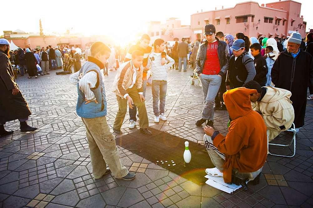 Moroccan people playing street games in Place Djemaa El Fna, the famous square in Marrakech, Morocco, North Africa, Africa