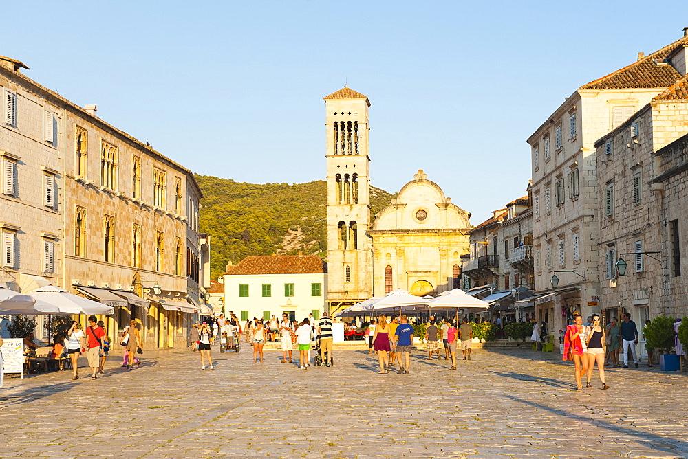 Tourists on holiday in St. Stephens Square, Hvar Town, Hvar Island, Dalmatian Coast, Croatia, Europe