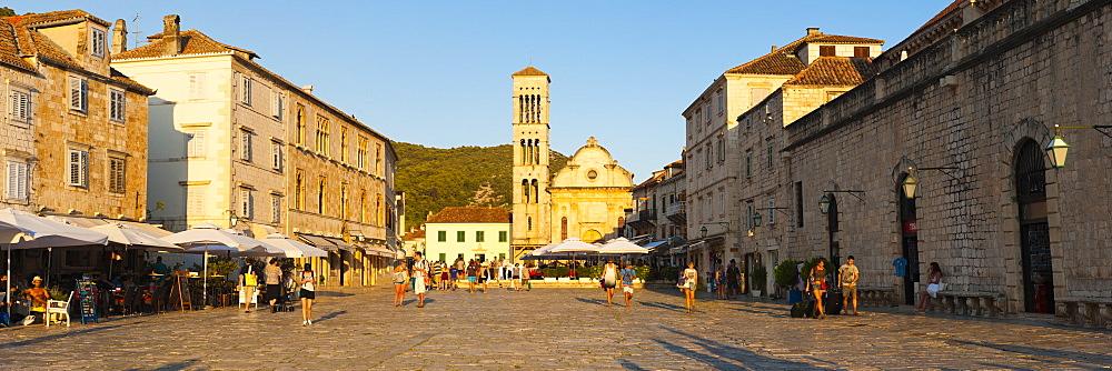 Tourists in St. Stephens Square, Hvar Town, Hvar Island, Dalmatian Coast, Croatia, Europe