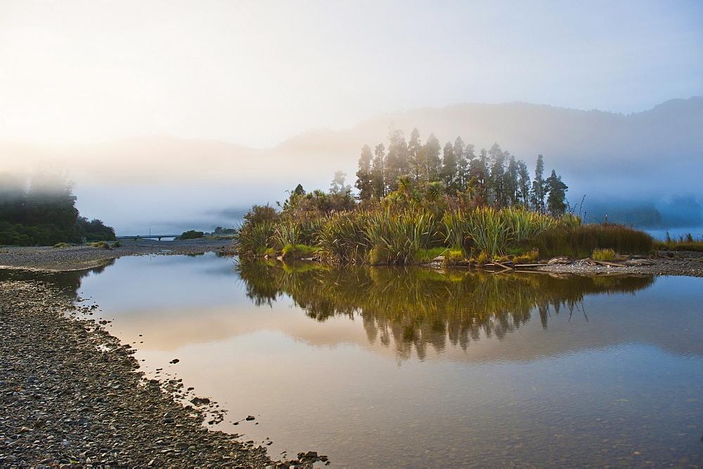 Misty Waitangitanoa River at sunrise, Westland National Park, UNESCO World Heritage Site, on the West Coast of South Island, New Zealand, Pacific