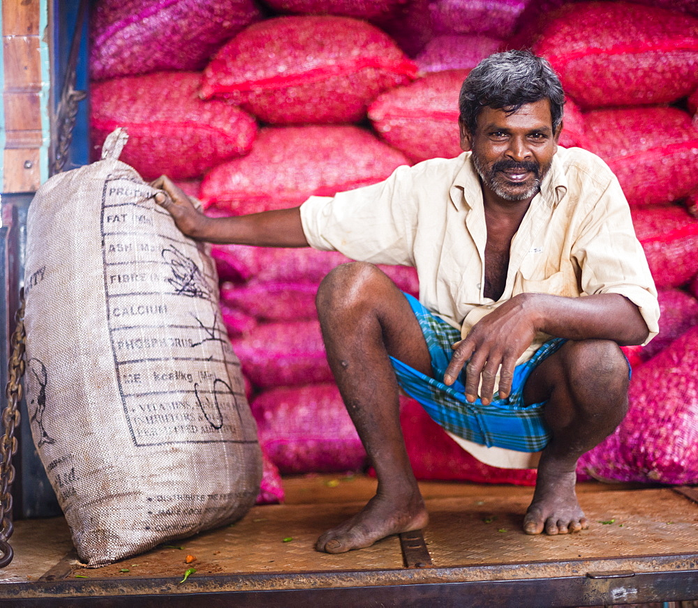 Portrait of a worker at Dambulla vegetable market, Dambulla, Central Province, Sri Lanka, Asia