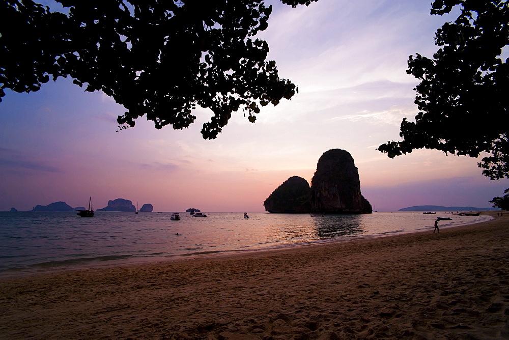 Colourful purple tropical sunset at Ao Phra Nang Beach, Railay (Rai Leh), South Thailand, Southeast Asia, Asia