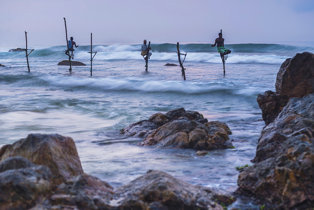 Stilt fishermen fishing at Midigama near Weligama, South Coast, Sri Lanka, Indian Ocean, Asia