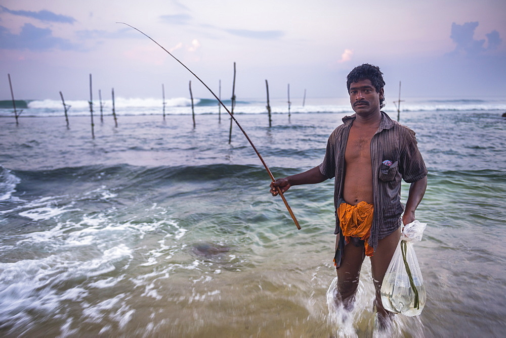 Stilt fisherman at Midigama near Weligama, South Coast, Sri Lanka, Indian Ocean, Asia