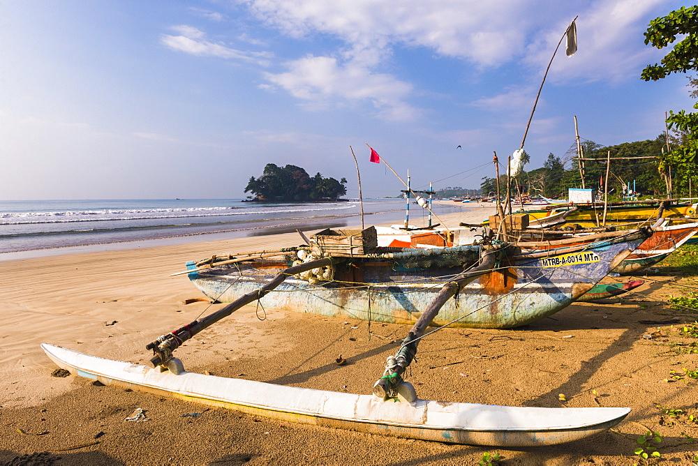 A fishing boat on Weligama Beach, South Coast of Sri Lanka, Indian Ocean, Asia