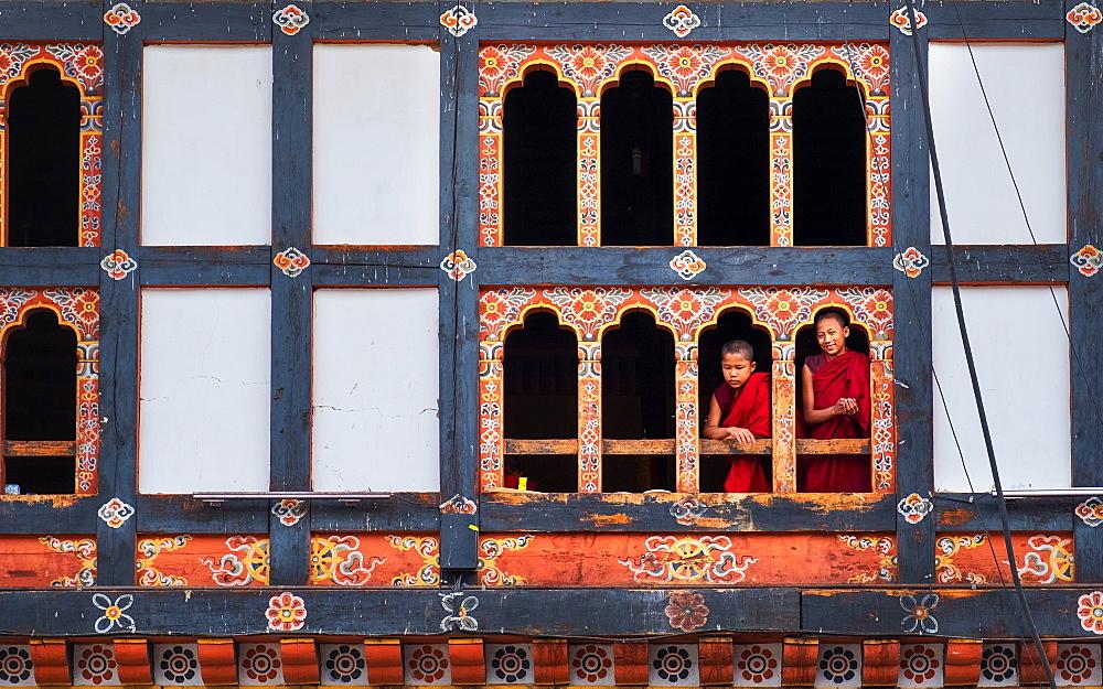 Bhutanese monks look through window frame, Kyichu Temple, Bhutan, Asia - 1111-105