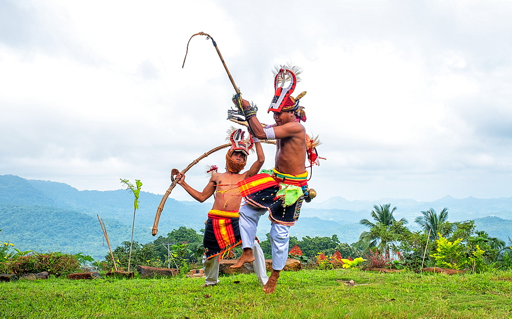 Caci men perform a traditional whip dance with bamboo shields and leather whips, western Flores, Indonesia.