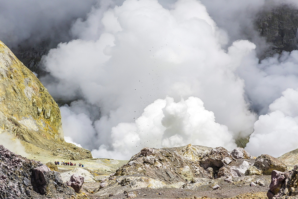 Visitors to an active andesite stratovolcano on White Island, off the East side of North Island, New Zealand, Pacific