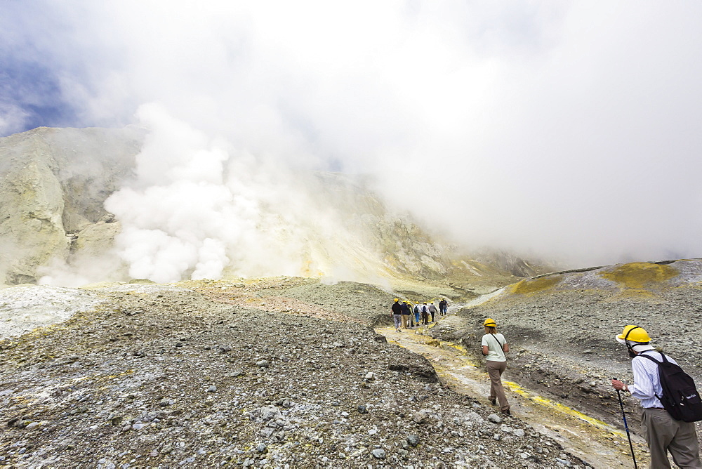 Visitors at an active andesite stratovolcano on White Island, North Island, New Zealand