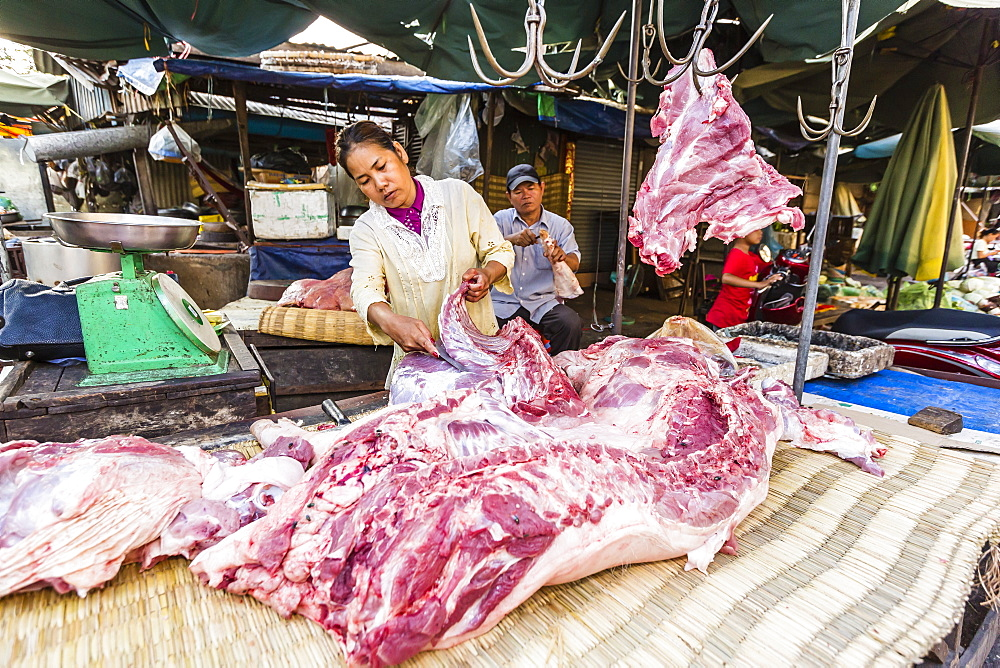 Fresh pork being prepared at street market in the capital city of Phnom Penh, Cambodia, Indochina, Southeast Asia, Asia