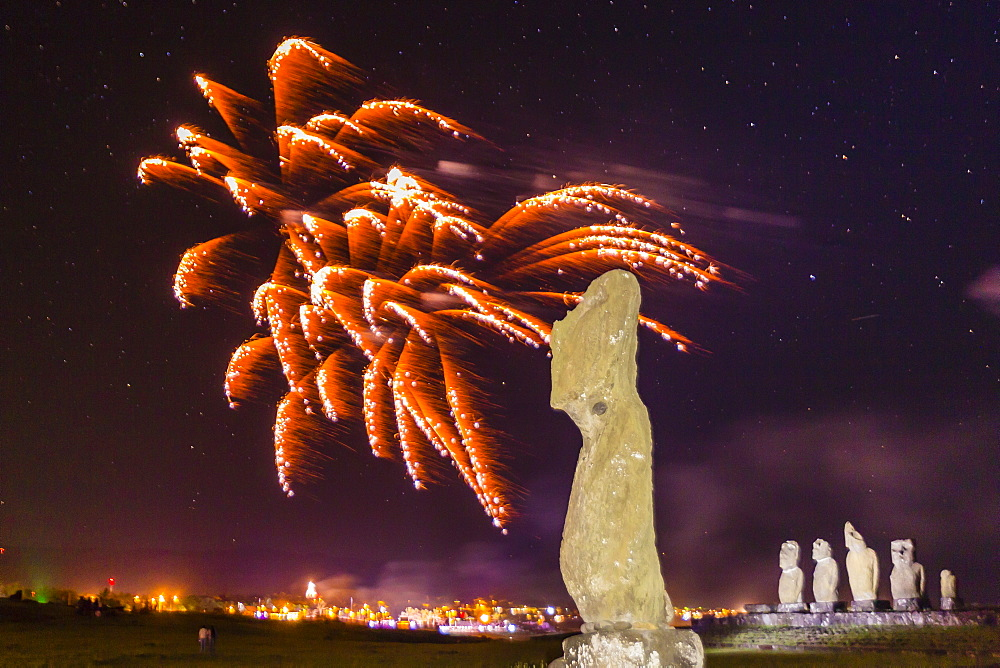 Fireworks ring in the New Year from the town of Hanga Roa over moai in the Tahai Archaeological Zone on Easter Island (Isla de Pascua) (Rapa Nui), UNESCO World Heritage Site, Chile, South America