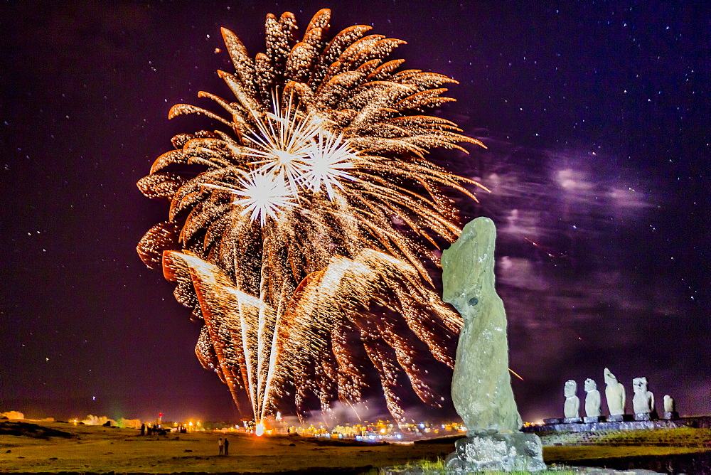 Fireworks ring in the New Year from the town of Hanga Roa over moai in the Tahai Archaeological Zone on Easter Island (Isla de Pascua) (Rapa Nui), UNESCO World Heritage Site, Chile, South America - 1112-1639