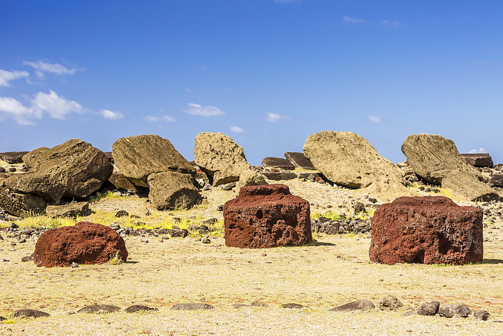 Fallen moai and red scoria topknots at Ura Uranga Te Mahina ceremonial site on Easter Island (Isla de Pascua) (Rapa Nui), UNESCO World Heritage Site, Chile, South America