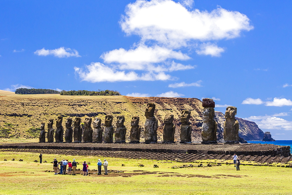 Tourists at the 15 moai restored ceremonial site of Ahu Tongariki on Easter Island (Isla de Pascua) (Rapa Nui), UNESCO World Heritage Site, Chile, South America