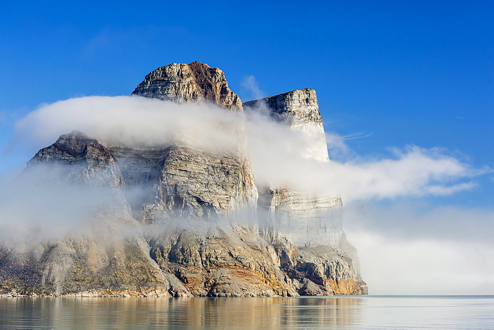 Fog lifting on the steep cliffs of Icy Arm, Baffin Island, Nunavut, Canada, North America