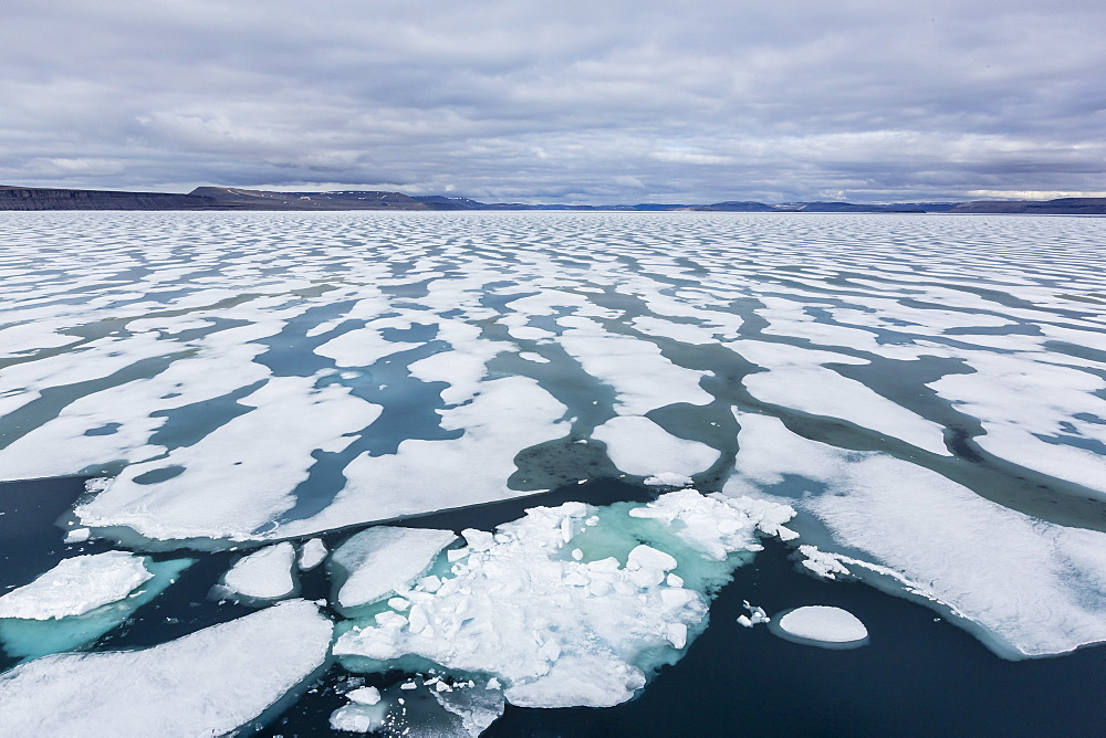 Shorefast ice starting to melt in Maxwell Bay, Devon Island, Nunavut, Canada, North America