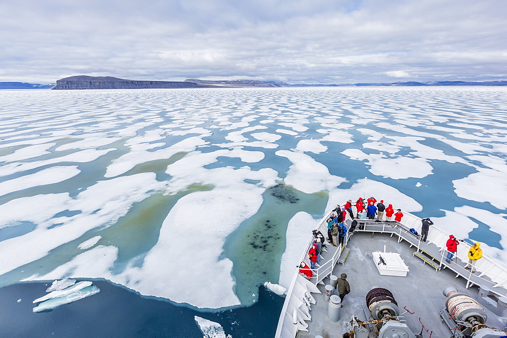 The Lindblad Expeditions ship National Geographic Explorer in Shorefast ice, Maxwell Bay, Devon Island, Nunavut, Canada, North America