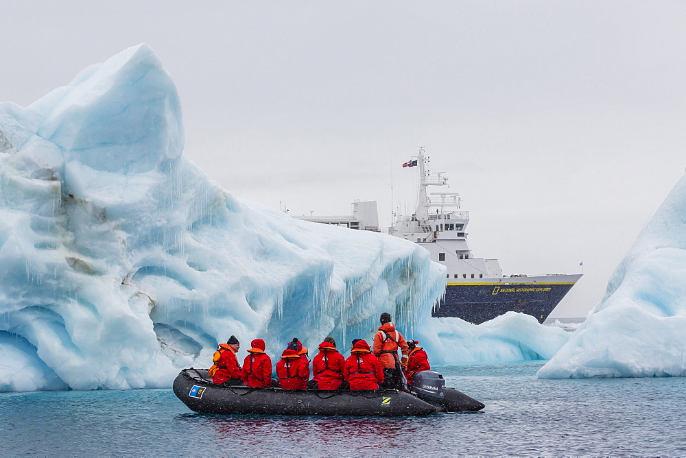 Lindblad Expeditions guests in a Zodiac approach a glacial iceberg at Brown Bluff, Weddell Sea, Antarctica, Polar Regions