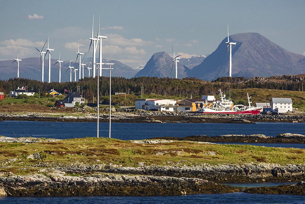 View of massive wind turbines in a wind farm near Smola Island, Norway, Scandinavia, Europe