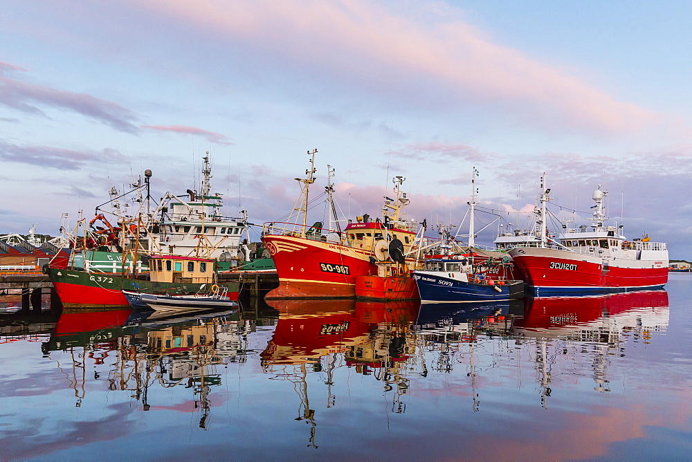 Sunset reflected on the commercial fishing fleet at Killybegs, the largest fishing port in Ireland, County Donegal, Ulster, Republic of Ireland, Europe