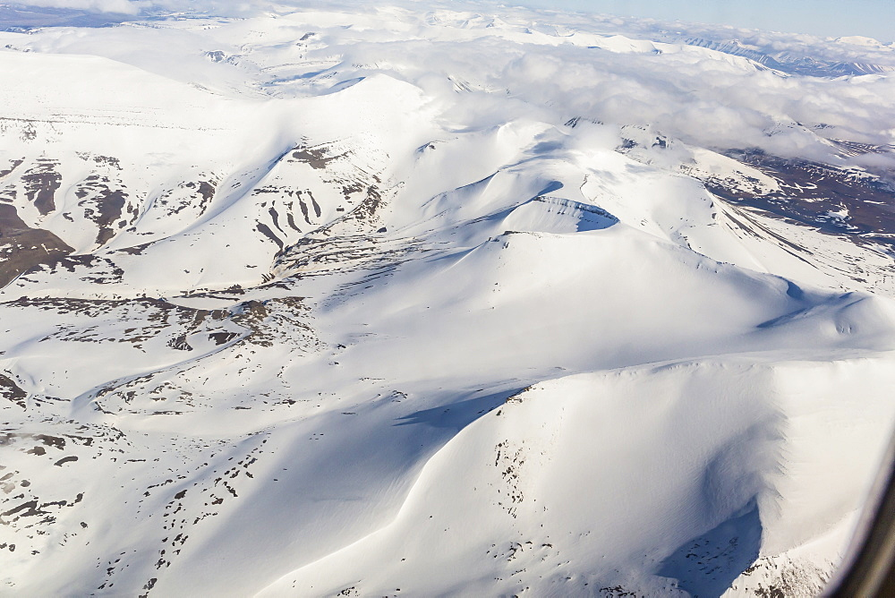 Aerial view of mountains, glaciers and ice fields on the west coast of Spitsbergen on a commercial flight from Longyearbyen to Oslo, Svalbard, Norway, Scandinavia, Europe