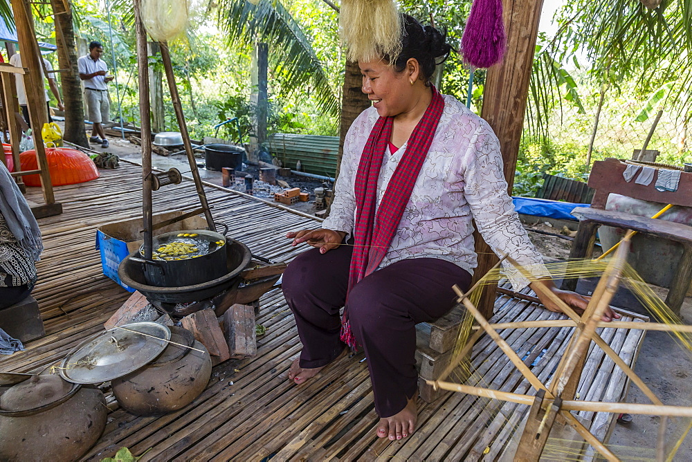 Hand spinning silk from silk worms in the village of Koh Oaknha Tey, Cambodia, Indochina, Southeast Asia, Asia