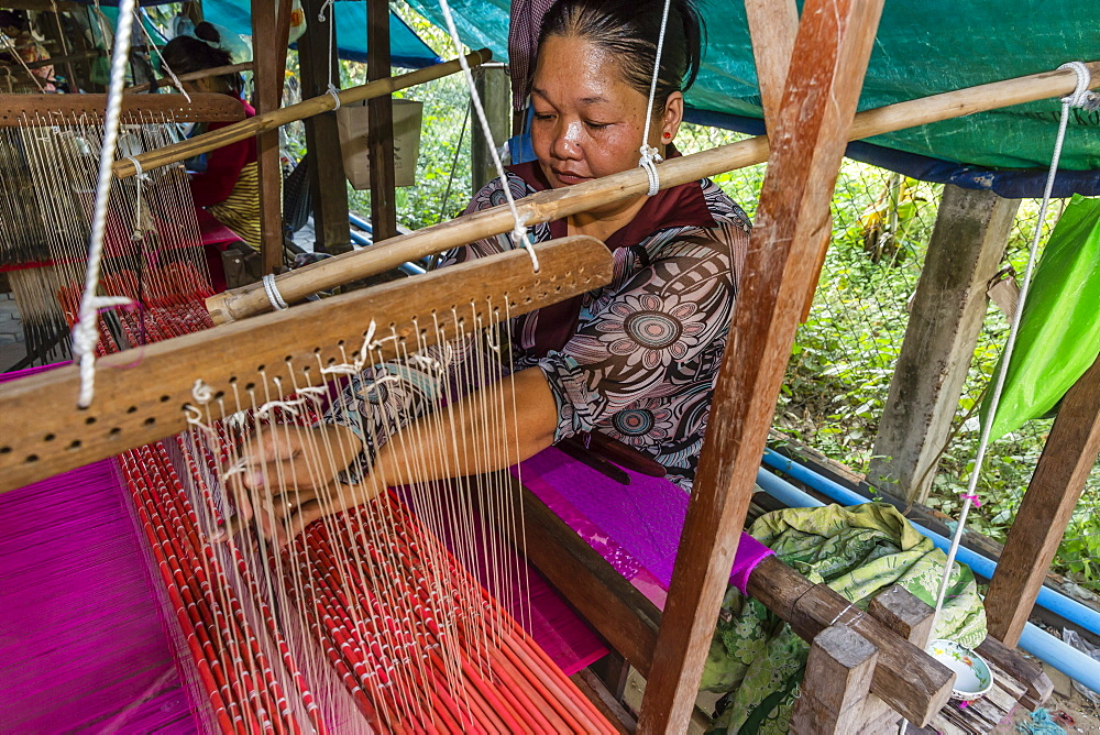 Hand weaving silk on a wooden loom in the village of Koh Oaknha Tey, Cambodia, Indochina, Southeast Asia, Asia