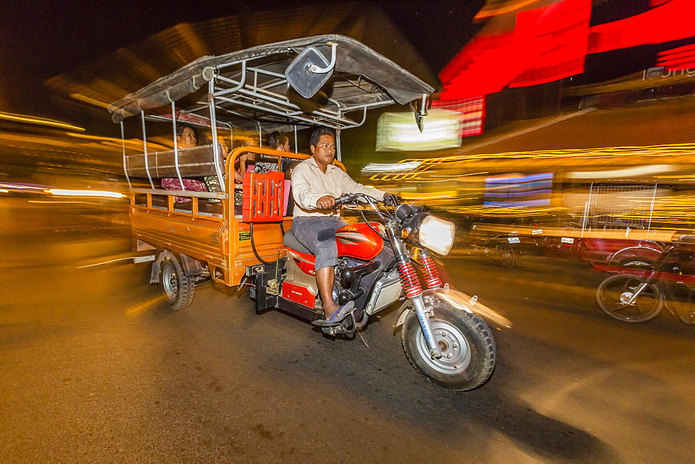 Night photograph of tuk-tuk and driver in the capital city of Phnom Penh, Cambodia, Indochina, Southeast Asia, Asia - 1112-2697