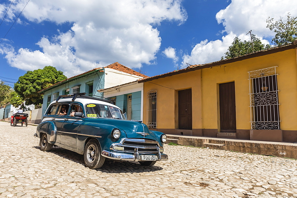 A vintage 1950's American car working as a taxi in the town of Trinidad, UNESCO World Heritage Site, Cuba, West Indies, Caribbean, Central America