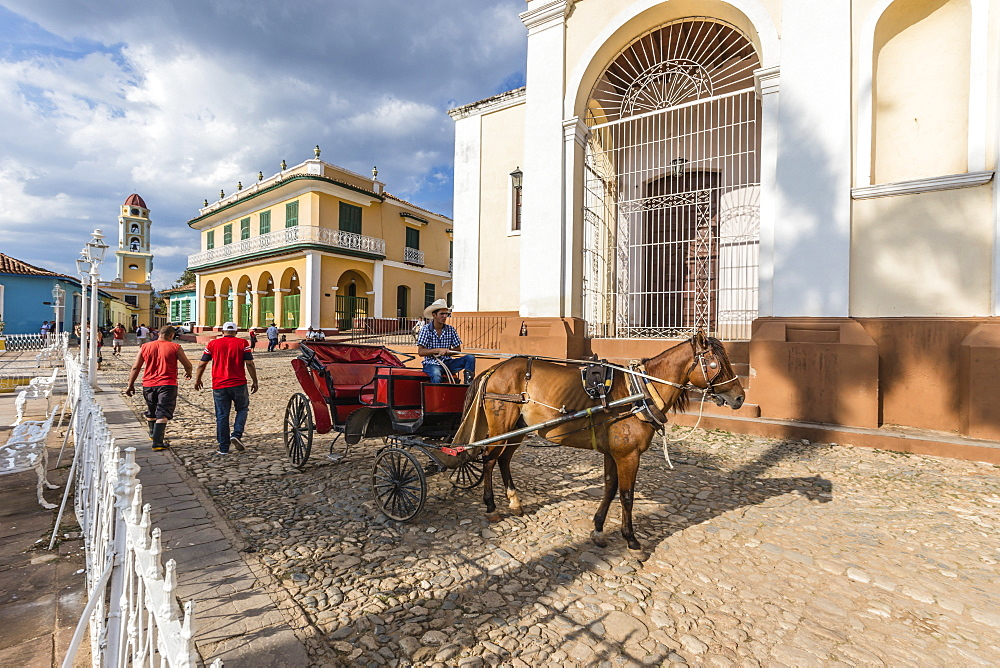 A horse-drawn cart known locally as a coche in Plaza Mayor, in the UNESCO World Heritage town of Trinidad, Cuba.