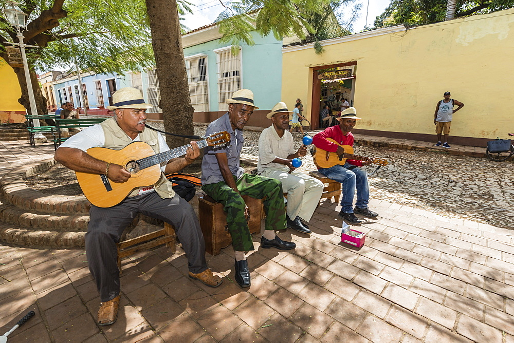 Street performers playing in the city of Trinidad, UNESCO World Heritage Site, Cuba, West Indies, Caribbean, Central America