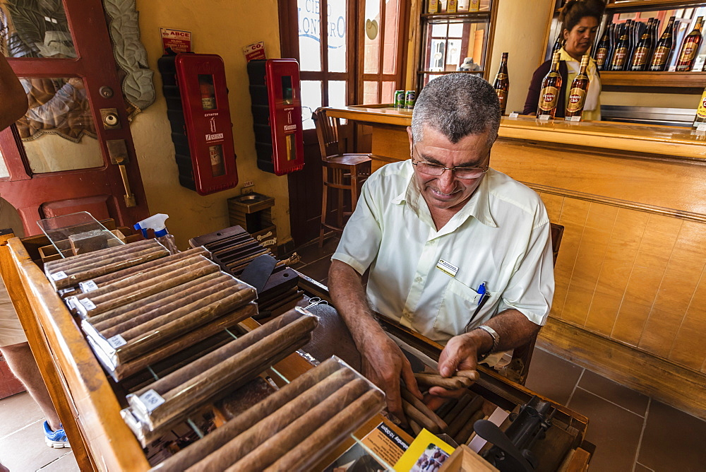 Hand rolling Cuban cigars in the UNESCO World Heritage site city of Trinidad, Cuba.