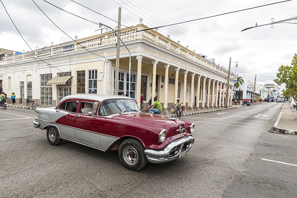 Classic 1950s Oldsmobile taxi, locally known as almendrones in the town of Cienfuegos, Cuba, West Indies, Caribbean, Central America