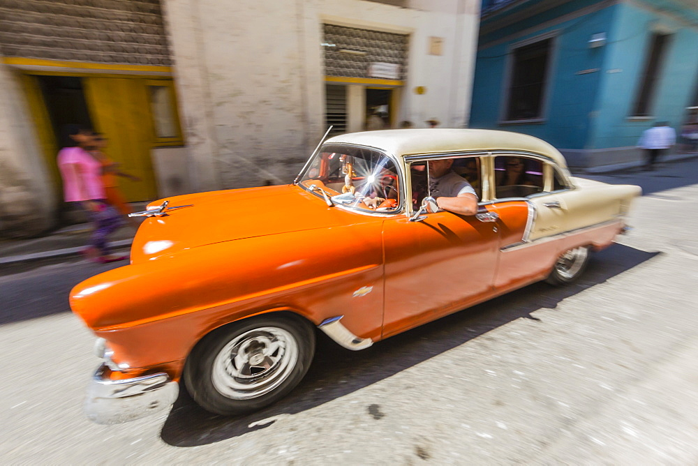 Classic American car being used as a taxi, locally known as almendrones in Havana, Cuba, West Indies, Central America