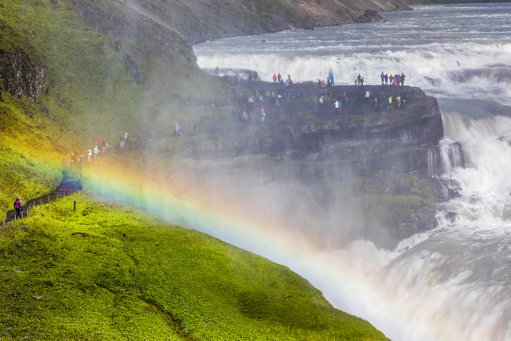 Tourists visiting iconic Gullfoss, Golden Falls, Olfusa River in southwest Iceland.