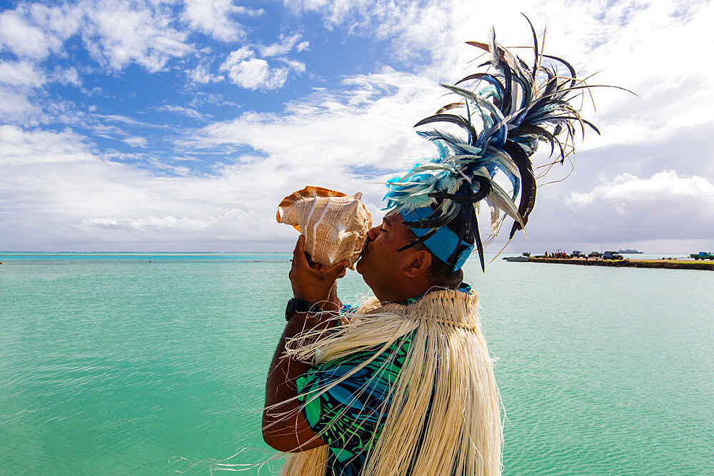 A conch shell blowing warrior welcoming guests to Aitutaki, Cook Islands. - 1112-3885