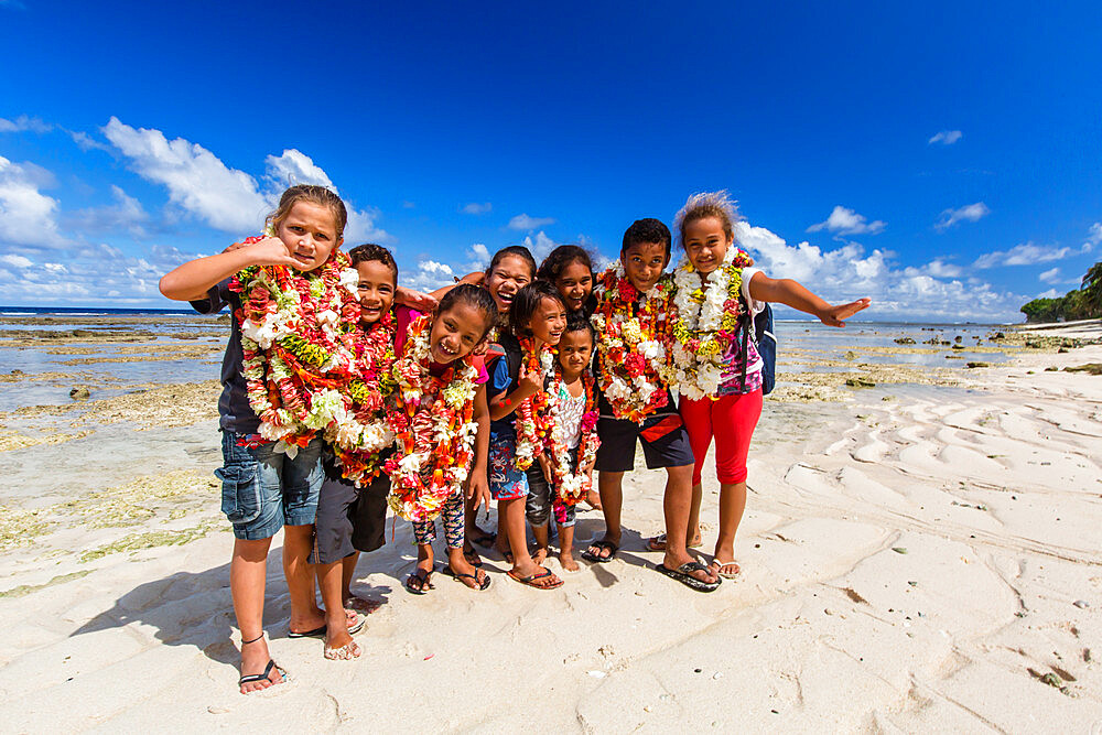 Local children greeting visitors on Vele Beach, Futuna Island, French Territory of Wallis and Futuna Islands.