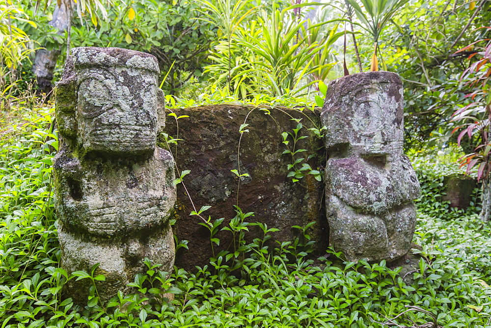Twin tikis marking the Christian gravesite of Te hau moe in Puama'u, Hiva Oa, Marquesas, French Polynesia, South Pacific, Pacific