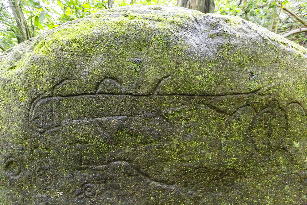 Petroglyphs carved into basalt on sacred ground at Hatiheu, Nuku Hiva, Marquesas, French Polynesia, South Pacific, Pacific