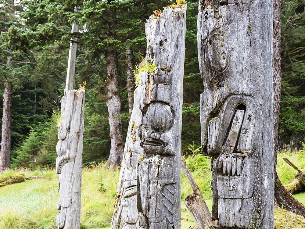 Totem poles at SGang Gwaay, UNESCO World Heritage Site, Haida Gwaii, British Columbia, Canada, North America