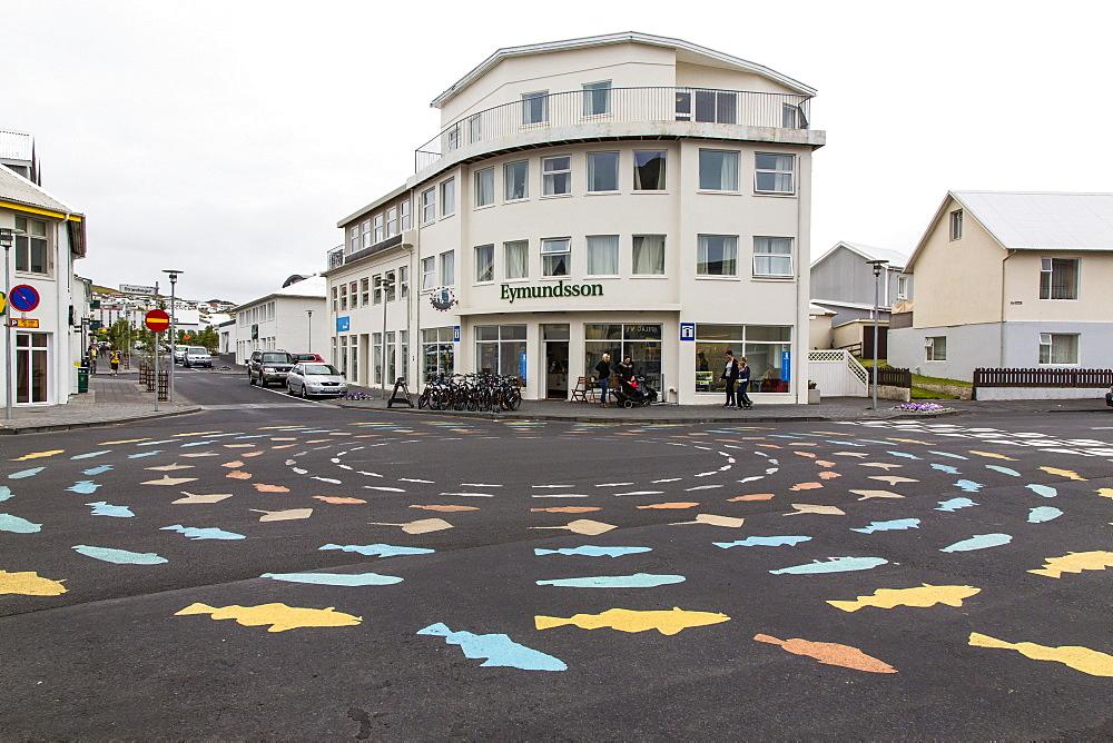 Painted fish on traffic circle on Heimaey Island, Iceland, Polar Regions