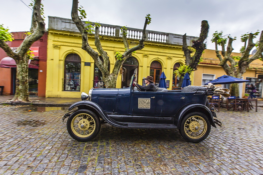 Old car used as taxi on cobblestone street in Colonia del Sacramento, Uruguay, South America - 1112-602