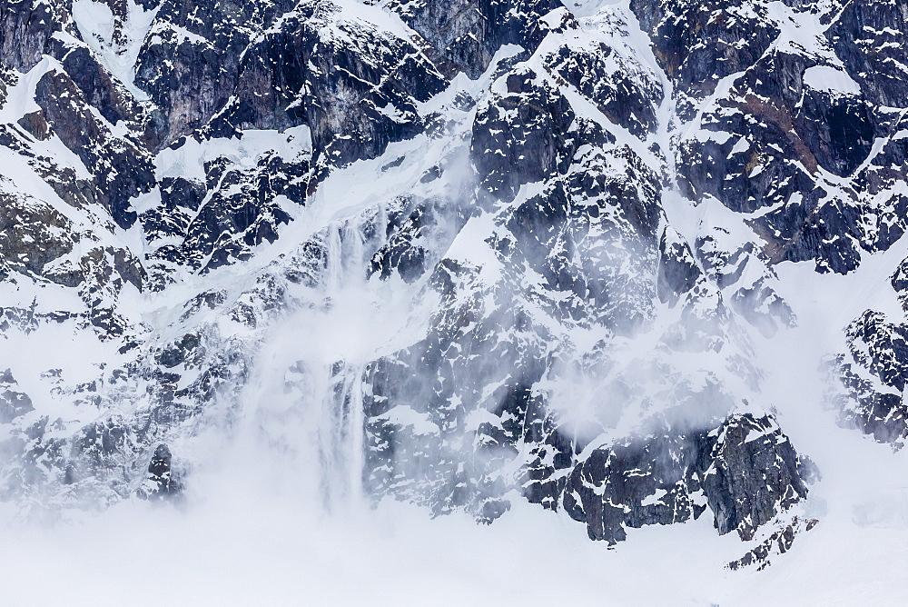 Ice cornice avalanche at Neko Harbor, western side of the Antarctic Peninsula, Antarctica, Polar Regions