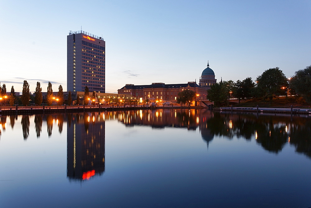 Pier of the ship company Weisse Flotte in the evening, Havel, with Hotel Mercure, Potsdam Palace and church of St. Nicholas in the background, Potsdam, Brandenburg, Germany