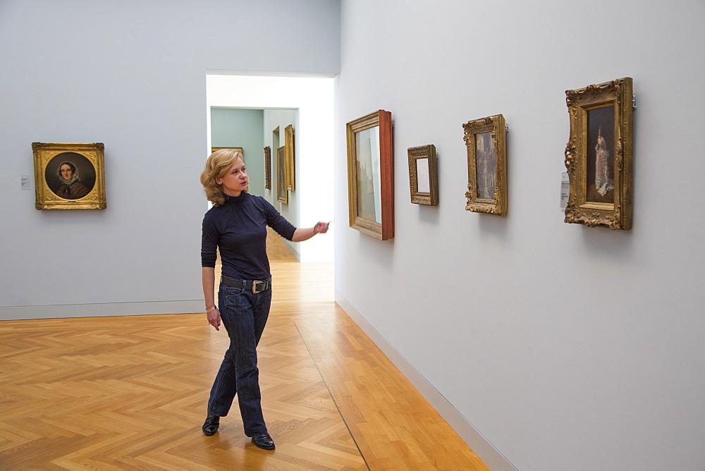 Woman explaining artwork in the Georg Schaefer Museum, Schweinfurt, Franconia, Bavaria, Germany
