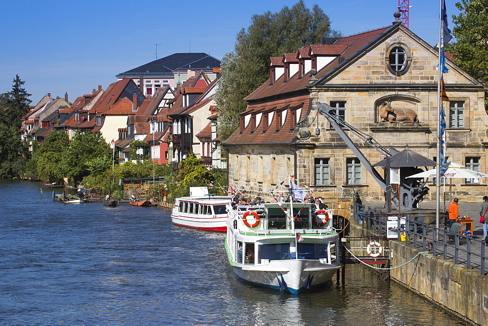 Sightseeing boat Christl and buildings of Klein Venedig Little Venice district alongside the left branch of the Regnitz river, Bamberg, Franconia, Bavaria, Germany