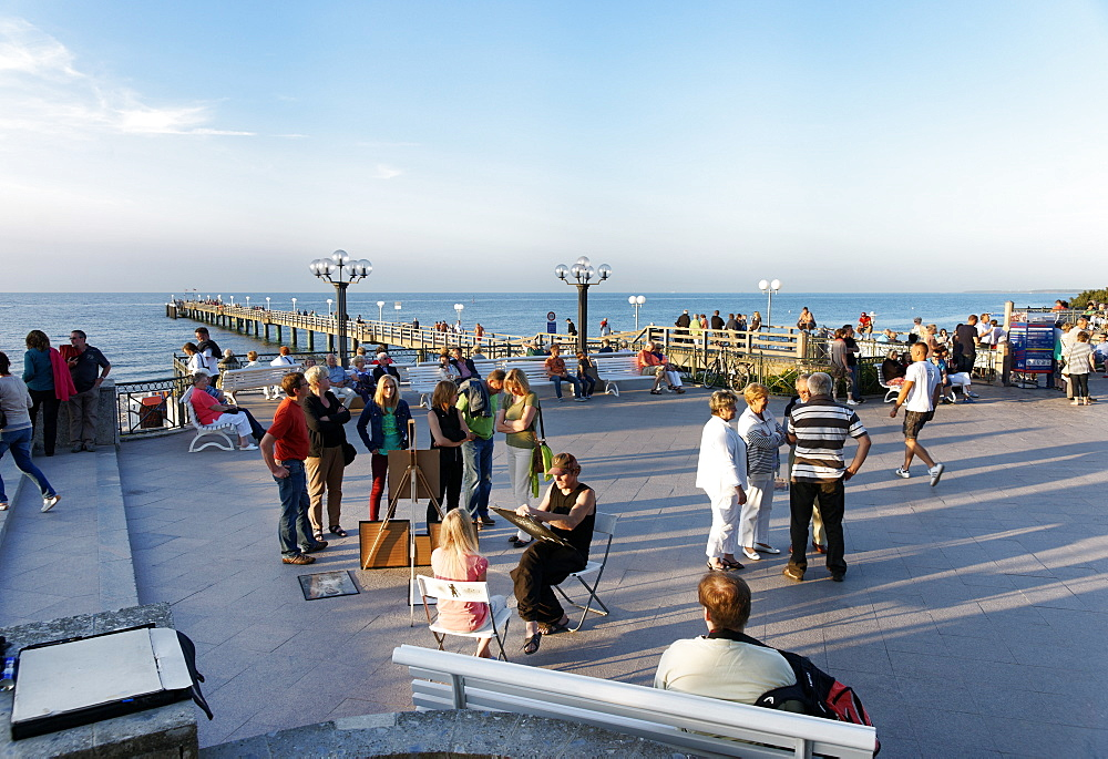 At the pier in the evening, seaside resort of Kuehlungsborn at the Baltic Sea, Mecklenburg-Western Pomerania, Germany