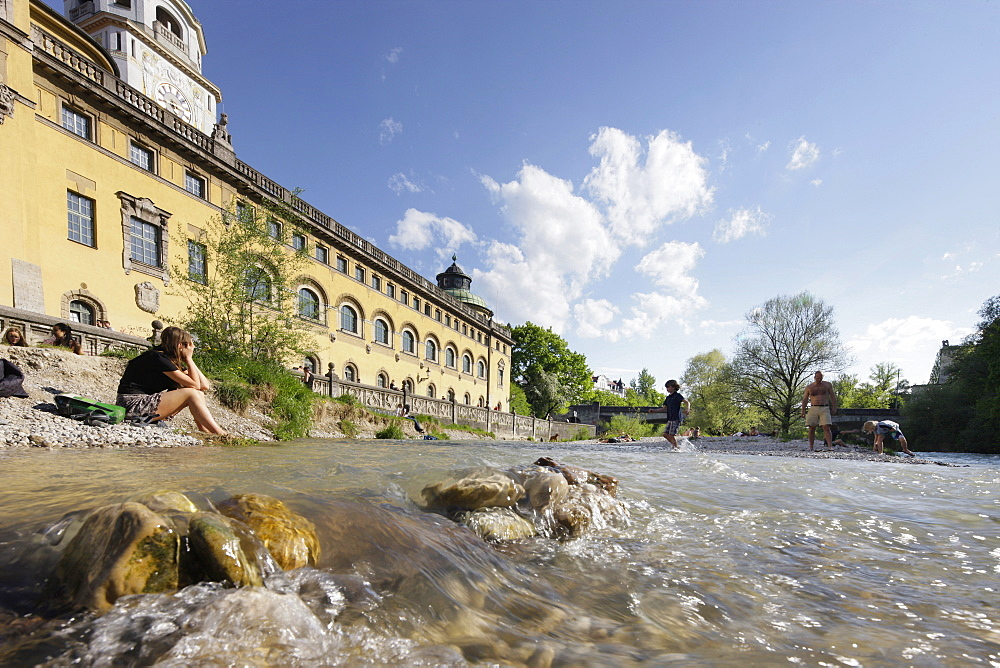 People relaxing at river Isar, Mullersches Volksbad, Munich, Bavaria, Germany